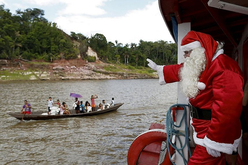 Gliding in with good tidings on the Amazon, Mr Claudionor Jose de Deus helped to deliver toys to poor children in Manaus, Brazil, on Saturday.
