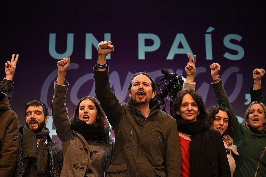Supporters of left-wing Podemos leader Pablo Iglesias celebrating the results of Spain's closely fought general election in Madrid on Sunday. Voters had rewarded newcomers from the anti-austerity Podemos and the liberal Ciudadanos parties, who betwee