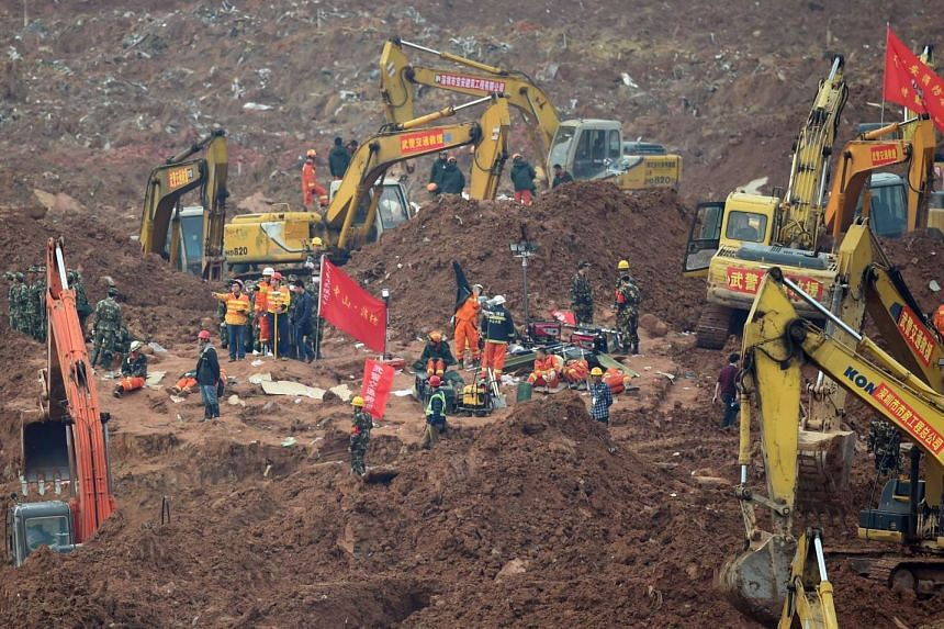 Rescue workers looking for survivors after a landslide hit an industrial park in Shenzhen, south China's Guangdong province on Dec 22, 2015.