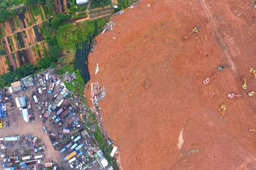 In this aerial photograph, Chinese rescuers work at the site of a landslide that hit an industrial park in Shenzhen in south China's Guangdong province on Dec 21, 2015.