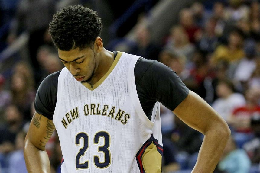 New Orleans Pelicans forward Anthony Davis reacting against the Boston Celtics during the fourth quarter of a game at the Smoothie King Center.