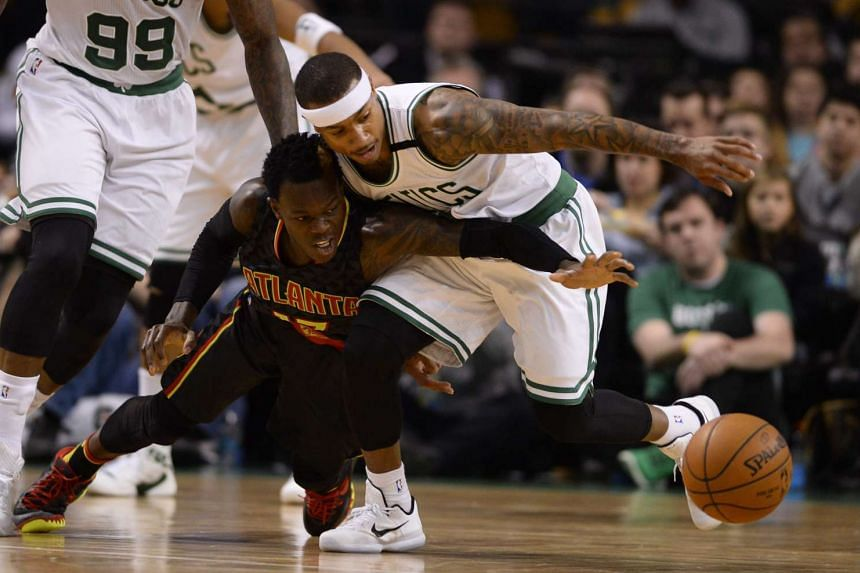 Atlanta Hawks guard Dennis Schroeder of Germany (left) and Boston Celtics guard Isaiah Thomas reaching for a loose ball during the first half of their NBA game at the TD Garden in Boston, Massachusetts, US, on Dec 18, 2015.
