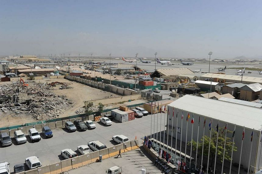 Vehicles and aircraft are seen parked at the Bagram Airfield, 50 kms north of Kabul, in 2011.