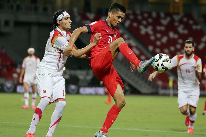 Singapore's Safuwan Baharudin in action with Syria's Alaa Al Shbbli during  a 2018 Fifa World Cup Qualifying football match.