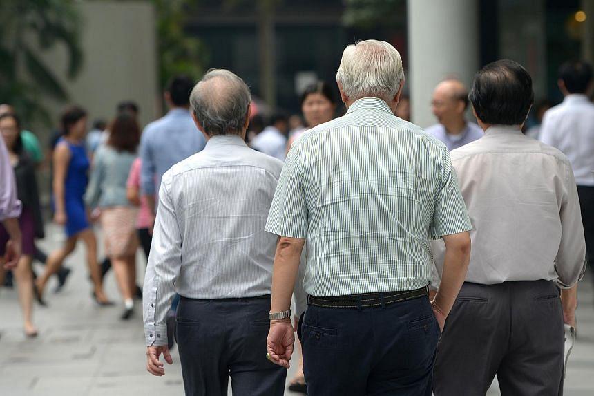 Elderly men at Raffles Place on Aug 24, 2015.