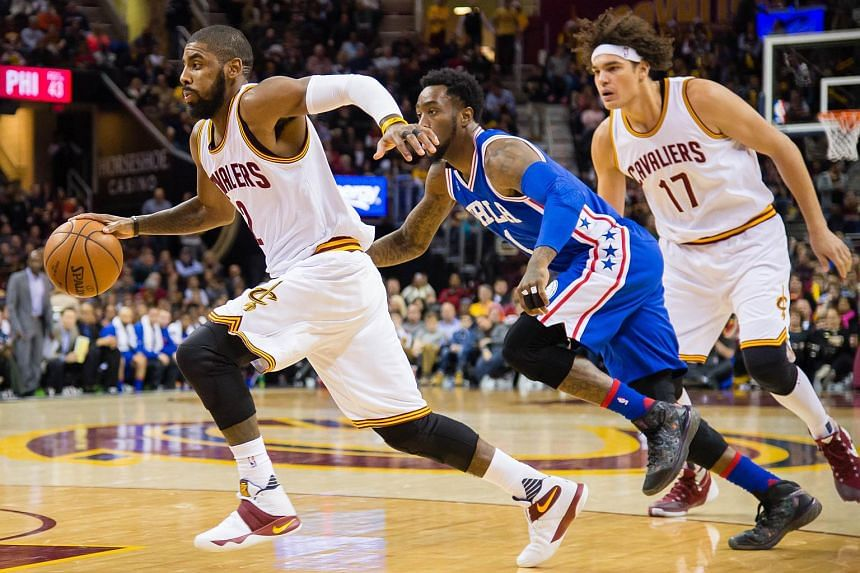 Kyrie Irving (2) of the Cleveland Cavaliers driving past Tony Wroten (1) of the Philadelphia 76ers during the first half at Quicken Loans Arena on Dec 20, 2015, in Cleveland, Ohio.
