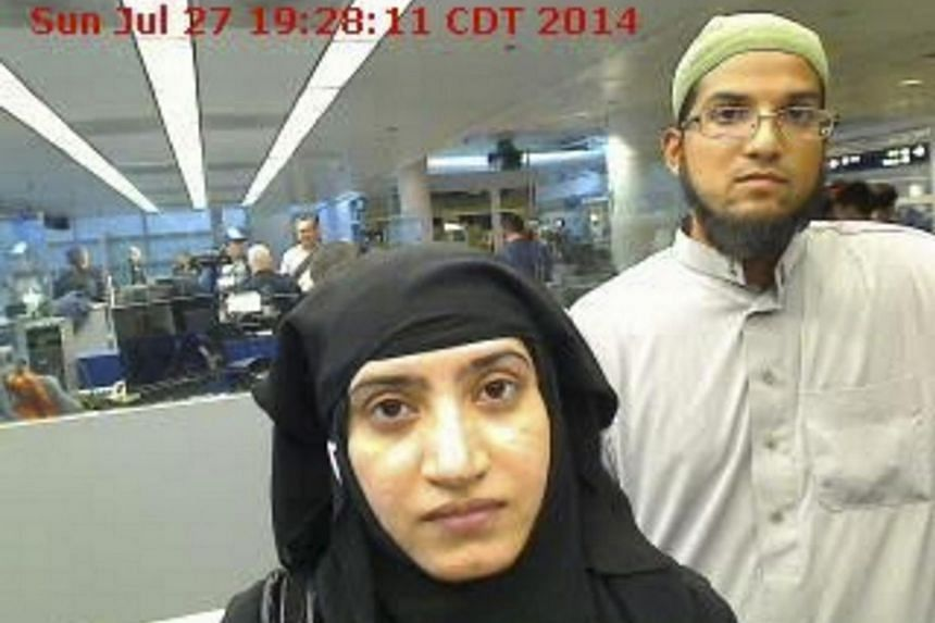 Tashfeen Malik (left) and Syed Farook are pictured passing through Chicago's O'Hare International Airport in this July 27, 2014 handout file photograph.