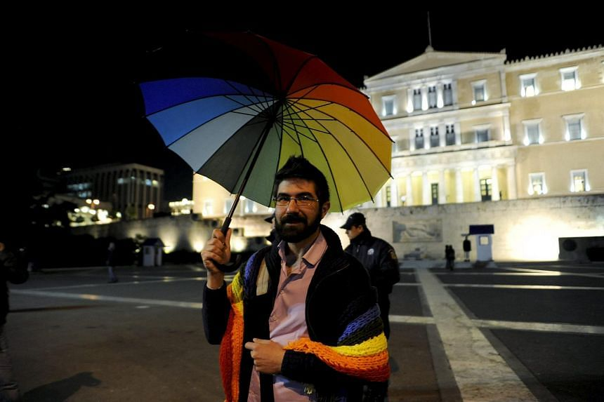 A gay rights activist protesting against homophobia in front of the parliament building in Athens, Greece, on Dec 22, 2015.