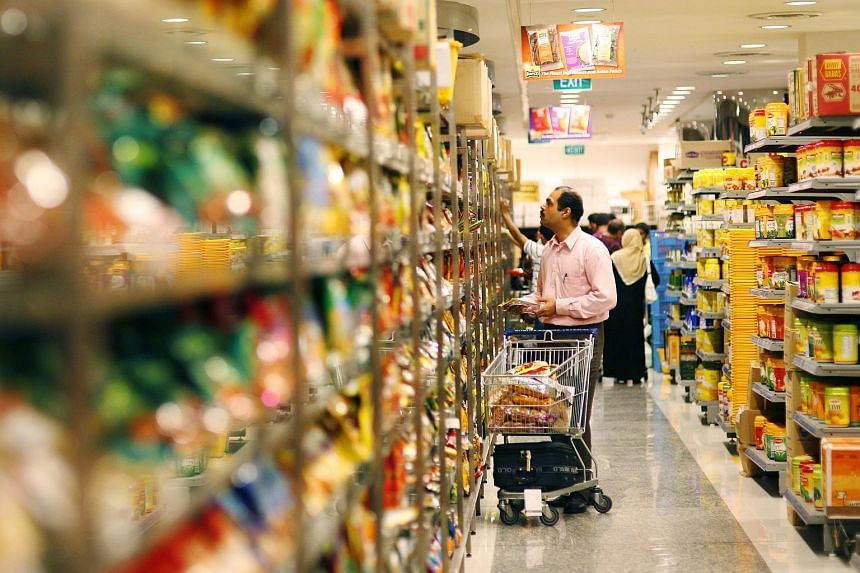 Shoppers perusing through products on the shelves of Mustafa Centre's supermarket.
