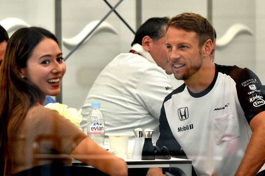 Jenson Button and his wife Jessica Michibata at the Japan Grand Prix on Sept 26, 2015.