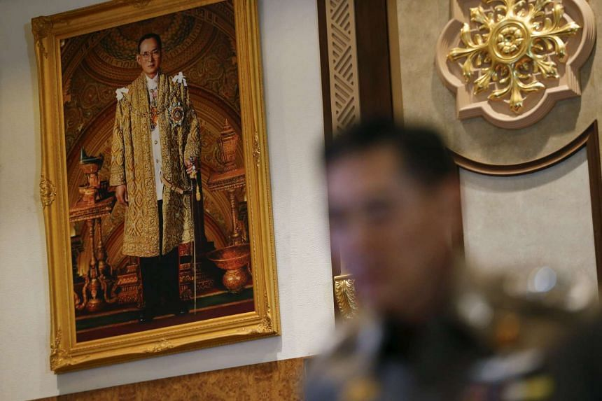 Thailand's national police chief Jakthip Chaijinda speaking to the media in front of a portrait of King Bhumibol Adulyadej during a news conference at Royal Thai Police headquarters on Oct 28, 2015.