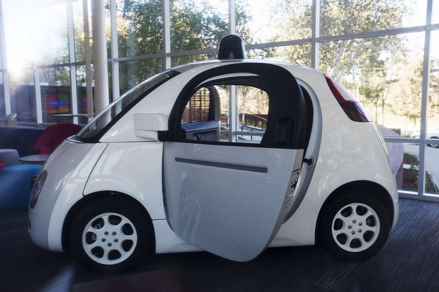 A Google self-driving car is seen inside a lobby at the Google headquarters in Mountain View, California.