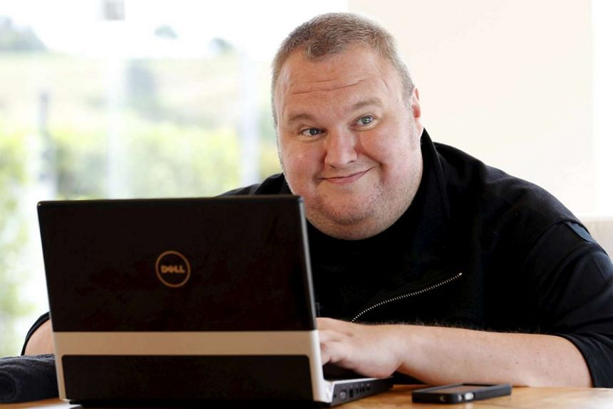 Kim Dotcom smiling during an interview with Reuters in Auckland on Jan 19, 2013.