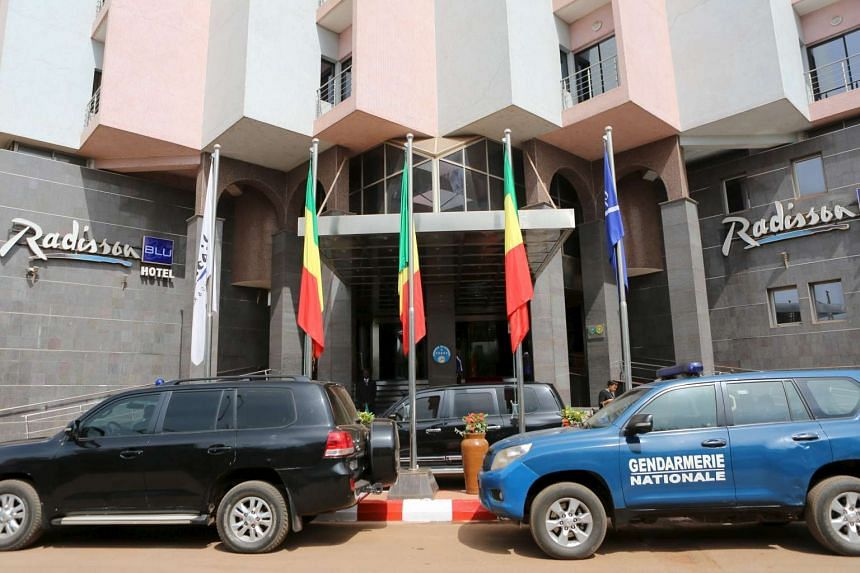 Cars are seen parked in front of the Radisson Blu hotel after it reopened in Bamako, Mali.