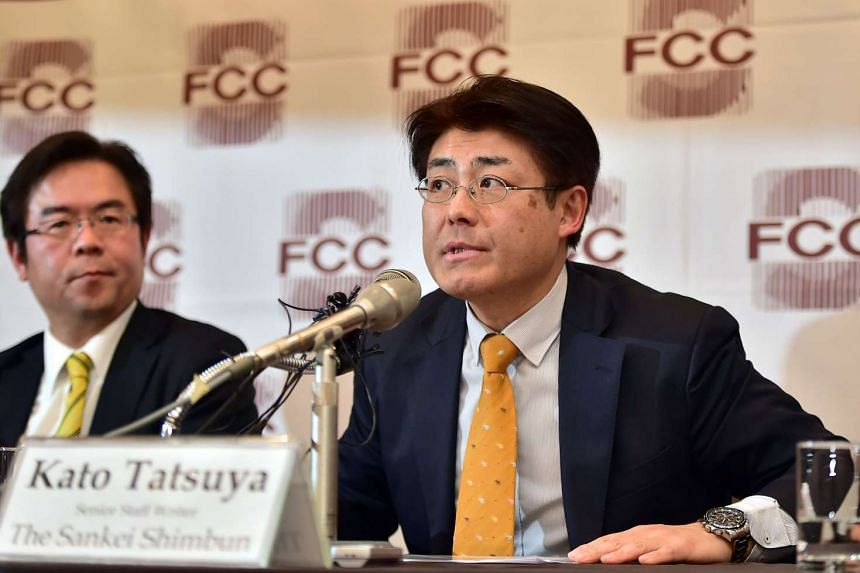 Sankei Shimbun newspaper journalist Tatsuya Kato (right) speaking during a press conference after attending court, at the Seoul Foreign Correspondents' Club on Dec 17, 2015.
