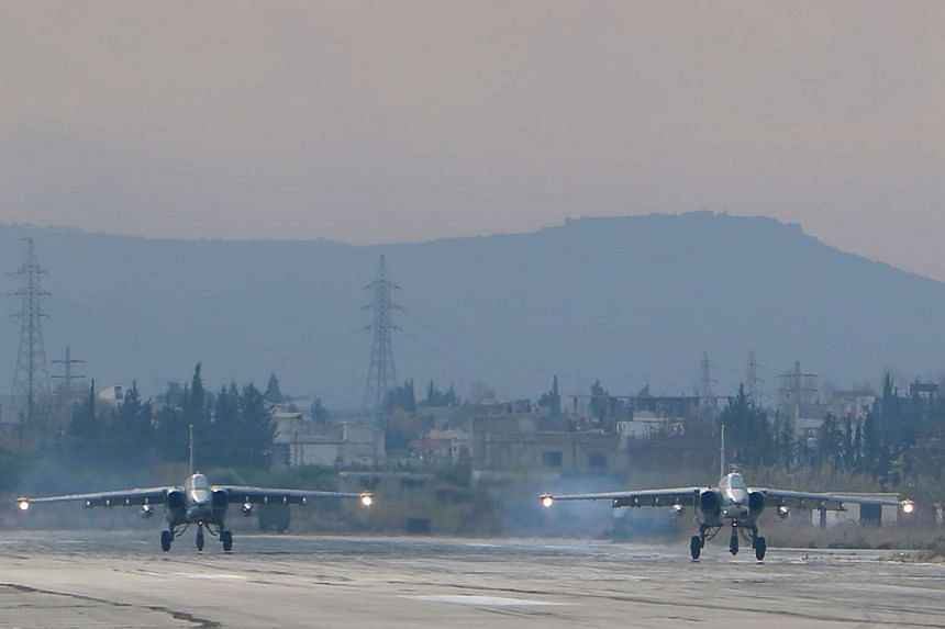 A file picture taken on Dec 16, 2015 shows two Russian Sukhoi Su-24 bombers at the Russian Hmeimim military base in Latakia province, in the northwest of Syria.