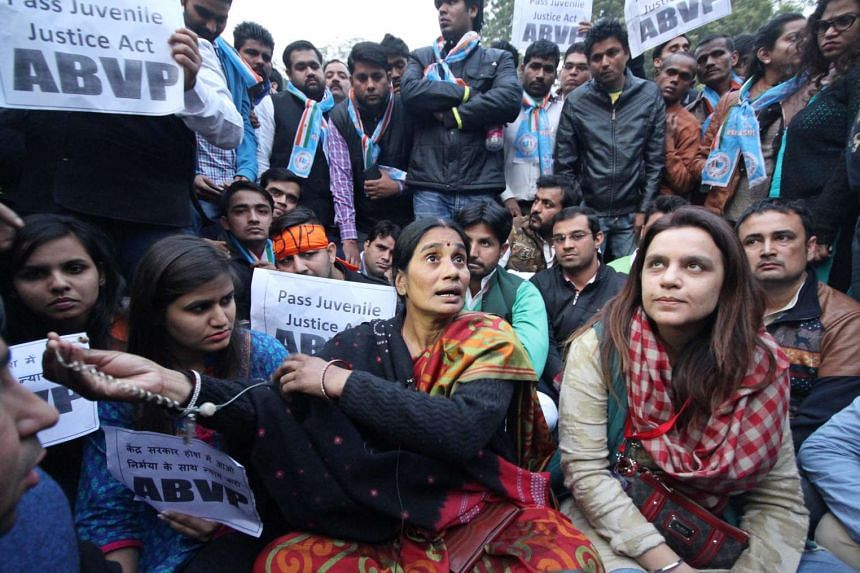 The mother (centre) of the murdered gang rape victim in 2012 takes part in a rally protesting the release of the youngest of six men found guilty of the crime, in New Delhi, India, on Dec 21, 2015.
