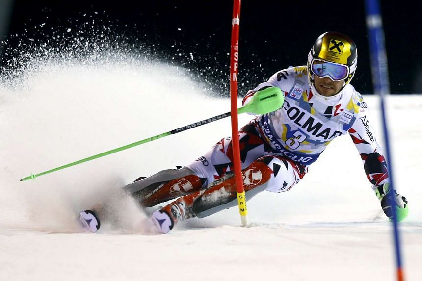 Marcel Hirscher clearing a gate during the first run in the men's slalom at the Alpine Skiing World Cup on Dec 22, 2015.
