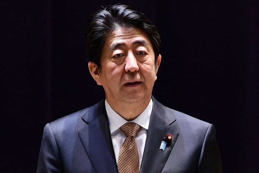Japan's PM Shinzo Abe delivering a speech before high-ranking Defence Ministry officials at the ministry in Tokyo on Dec 16, 2015.