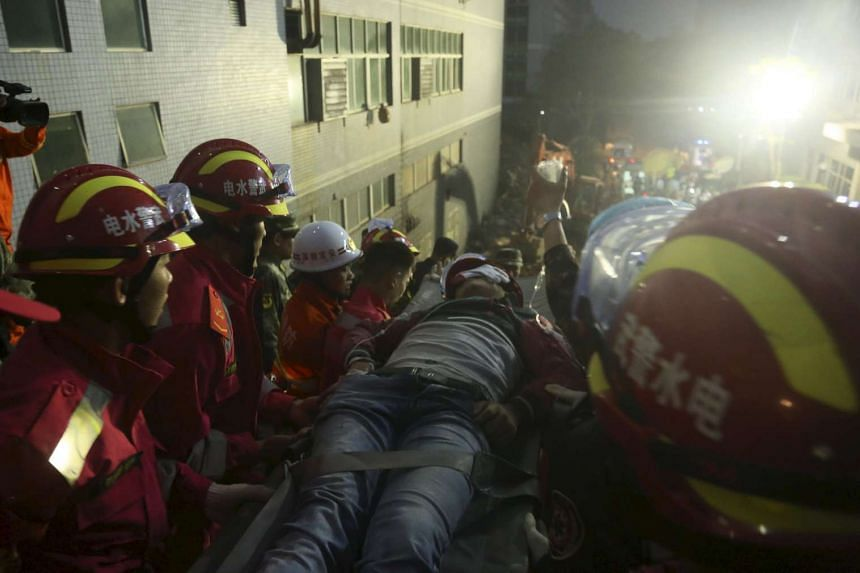 The 19-year-old survivor on a stretcher after being pulled out by rescuers more than 60 hours after the landslide.