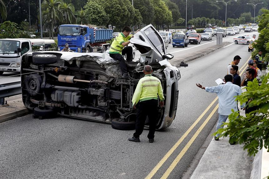 A van flipped on its side on the Pan-Island Expressway yesterday. No injuries were reported from the accident, which occurred along a slip road near the Old Police Academy. Police received a call at around 4.40pm and are investigating.