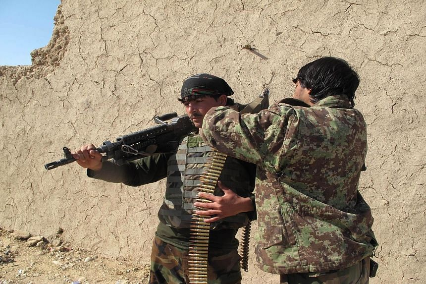 Afghan National Army soldiers adjusting their equipment in Helmand on Monday. The deputy governor of the province warned that the area was at risk of falling to the Taleban, but the government rejected such assertions and said reinforcements had been