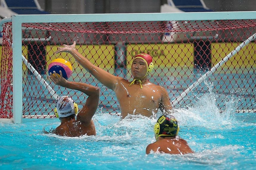 Singapore water polo club Pacer's goalkeeper Fong Wai Chun attempts to block a shot by Rohan Lee of Malaysian side Kinta. Pacer won 14-12 to claim the Under-16 category in the second edition of the Singapore Water Polo Junior Inter-Club Invitational