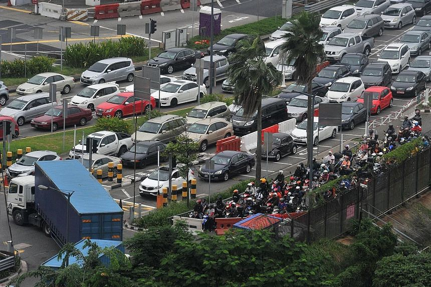 The massive traffic jam at the Causeway during the evening peak period last Friday. ICA said some of the reasons for the jam include the use of wrong, invalid travel documents, inconsiderate motorists and tighter security in the face of terrorist thr