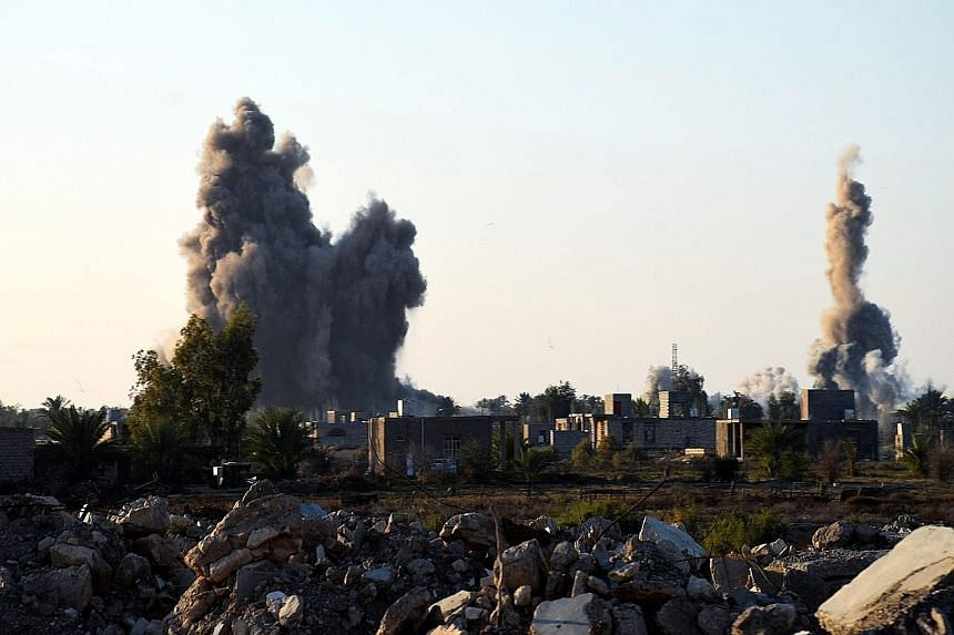 A supplied photo showing explosions from claimed US air strikes on Ramadi, some 100km west of Baghdad, last month.