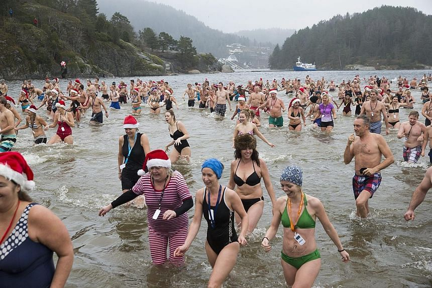 Members of a winter swimming club set a new Norwegian record with 395 bathers in the water at the same time in balmy Porsgrunn on Sunday, as people across Europe enjoyed the unusually warm December. There was no sign of snow in Oberaudorf, Germany, a