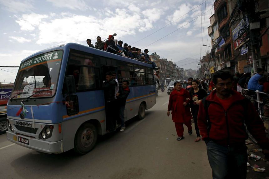 Passengers riding on an overcrowded bus as limited public transportation operates in the city during the fuel crisis in Kathmandu, Nepal, on Oct 30, 2015.
