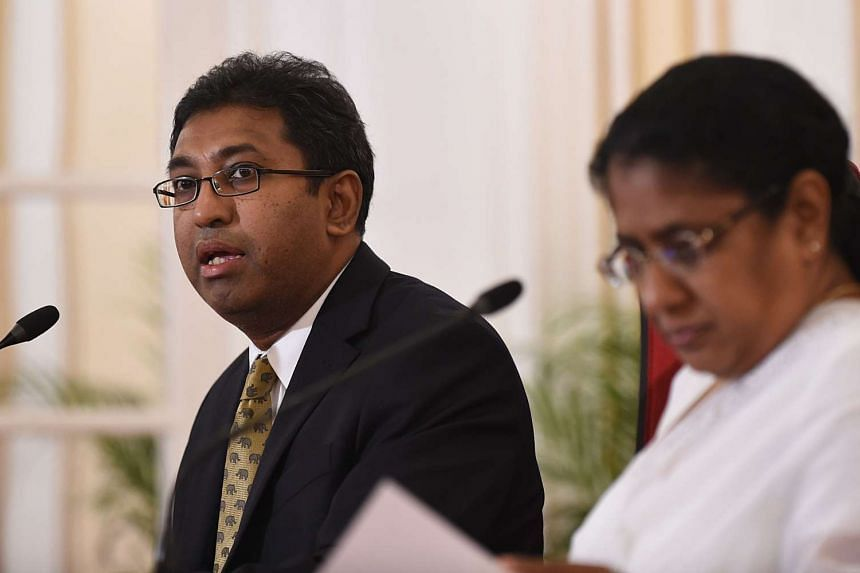 Sri Lankan deputy foreign minister Harsha de Silva (left) speaks  as Minister of Foreign Employment Thalatha Athukorala looks on during a press conference  in Colombo on Wednesday (Dec 23).
