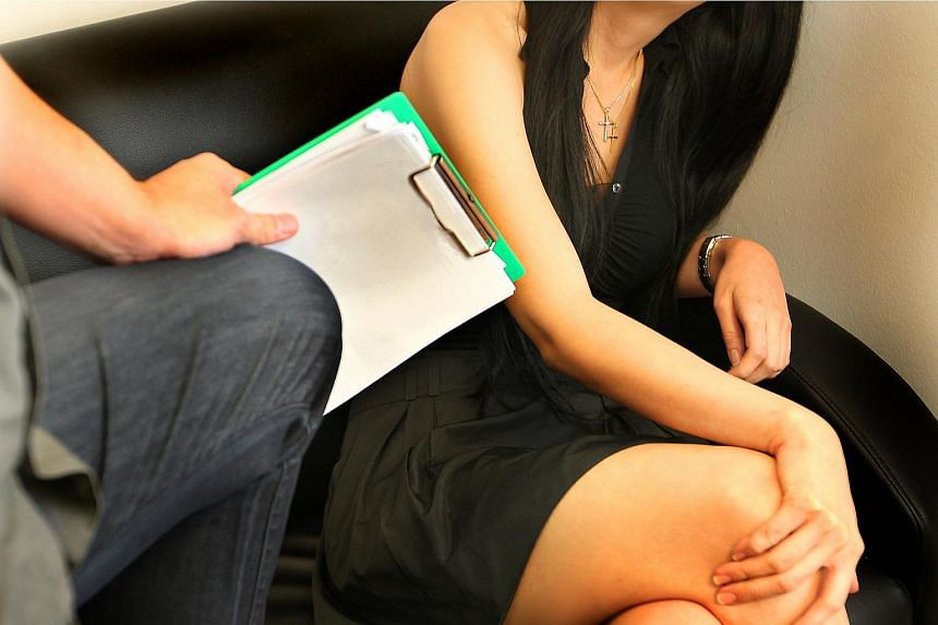 Posed photo to illustrate sexual harrassment in the workplace.