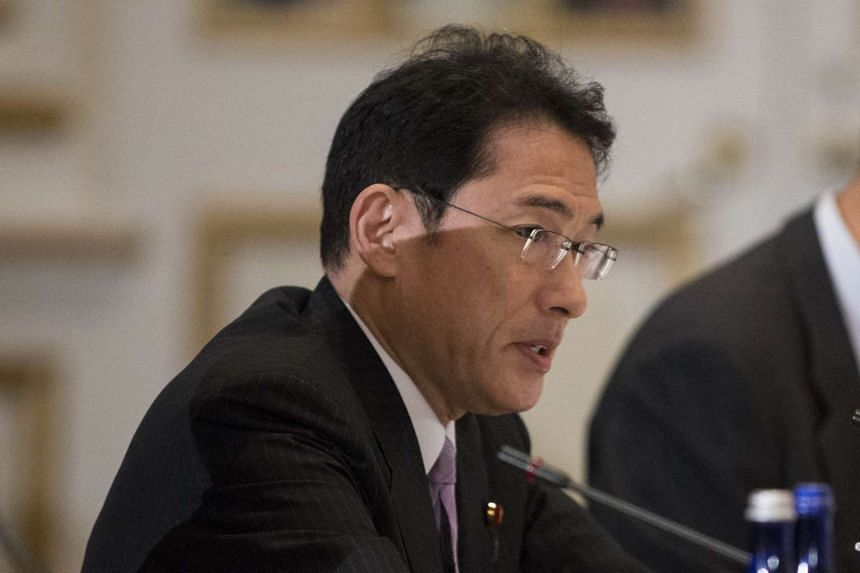 """Japanese Prime Minister Shinzo Abe told Foreign Minister Fumio Kishida (pictured) to visit Seoul by the end of the year to resolve the issue of """"comfort women""""."""