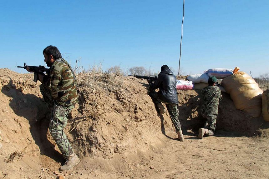 Afghan security forces take up positions during an operation against Taliban fighters in Helmand province, Afghanistan.