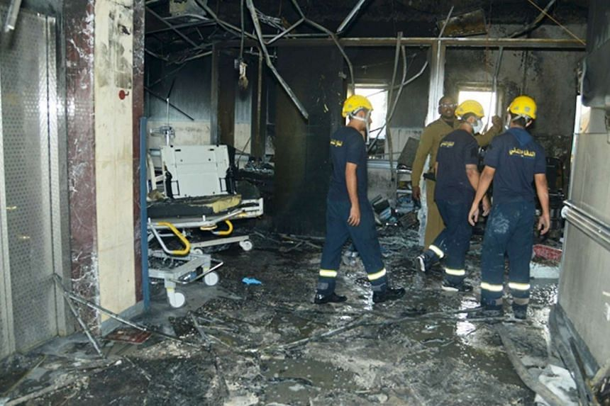 Saudi Civil Defence officers inspecting the damage at Jazan General Hospital following a pre-dawn fire, on Dec 24, 2015.