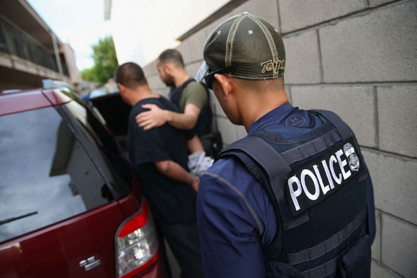 A man is detained by US Immigration and Customs Enforcement (ICE), agents on Oct 14, 2015 in Los Angeles.