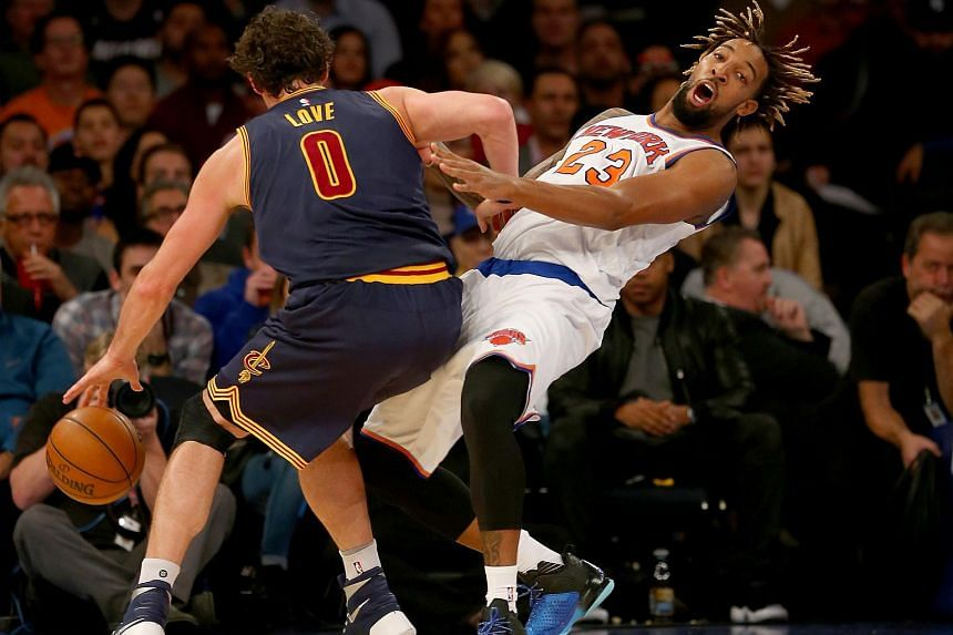 Kevin Love (left) of the Cleveland Cavaliers collides with Derrick Williams (right) of the New York Knicks at Madison Square Garden on Nov 13, 2015 in New York City.