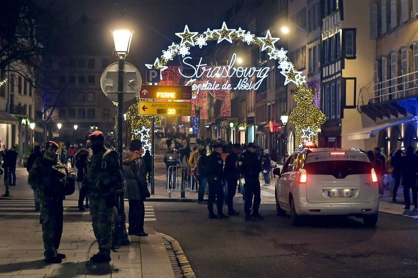 French soldiers and police patrol the entrance of the Christmas market in eastern France.