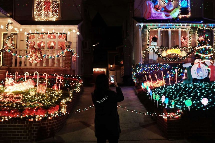 Christmas lights and other ornaments decorate a home in the Dyker Heights neighbourhood of Brooklyn, New York.