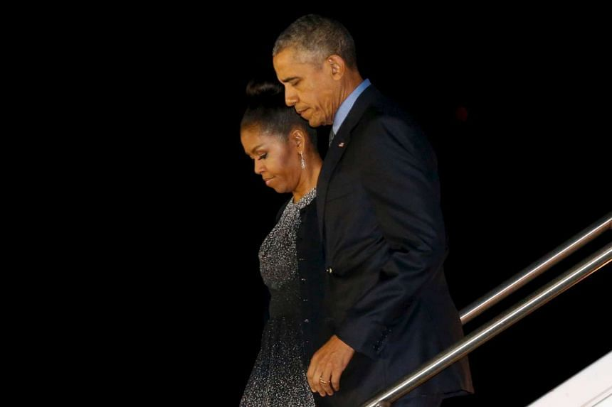 US President Barack Obama and first lady Michelle Obama arrive aboard Air Force One at San Bernardino International Airport.