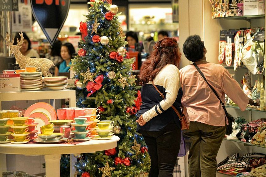 The Straits Times Index inched up 13.97 points to 2,877.62, ahead of the Christmas holiday.