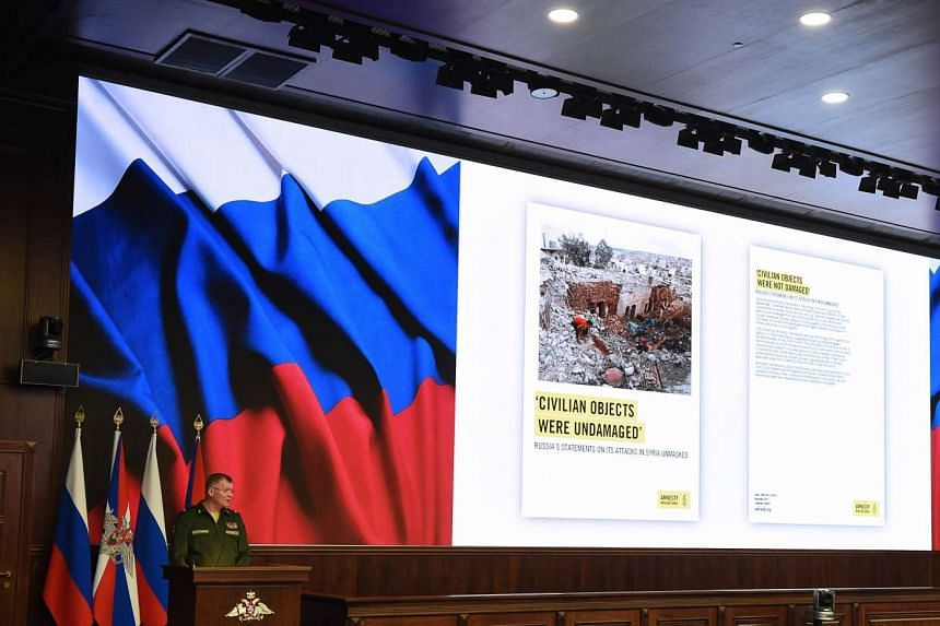 Russia's defence ministry spokesman Igor Konashenkov holds a press briefing on the fight against terrorism in Syria on Dec 23, 2015.