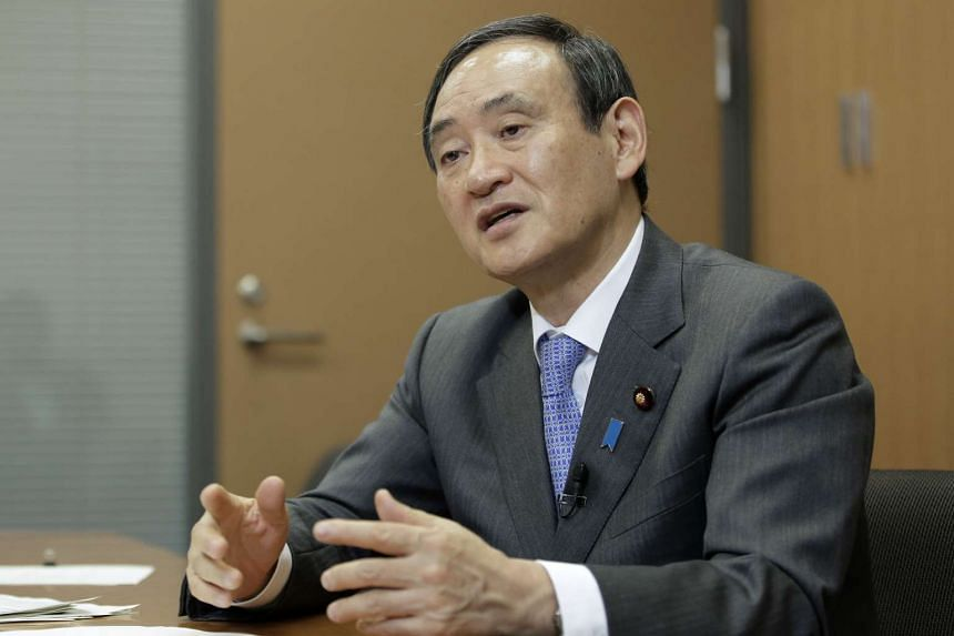 Yoshihide Suga, Japan's chief cabinet secretary, speaks during an interview in Tokyo.