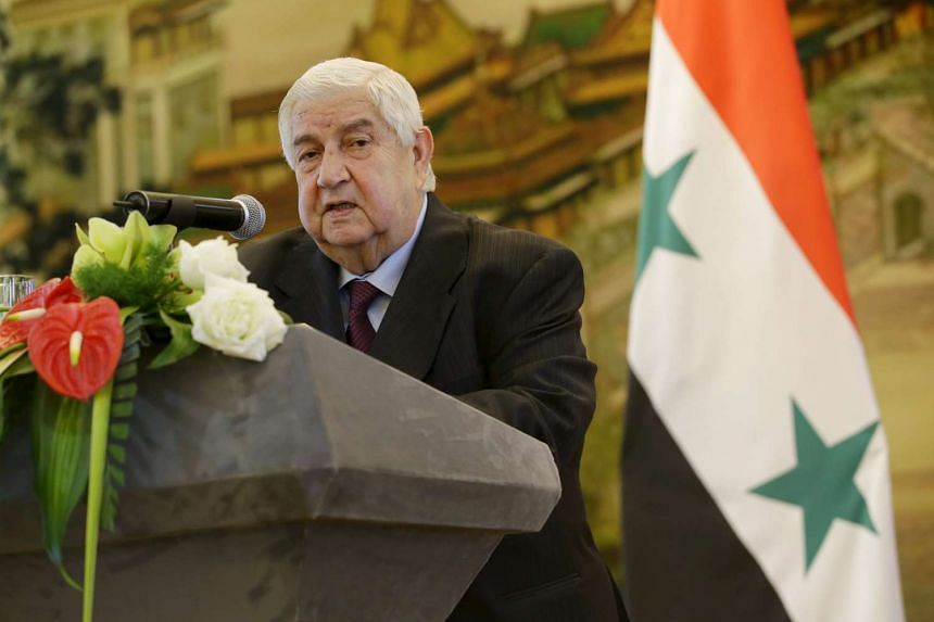 Syrian Foreign Minister Walid al-Moualem speaking during a news conference at the Ministry of Foreign Affairs in Beijing on Dec 24, 2015.