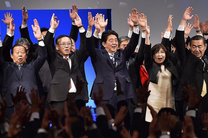 Prime Minister Shinzo Abe (centre) cheering with Liberal Democratic Party members at a ceremony to mark the 60th anniversary of the party's founding on Nov 29 in Tokyo.