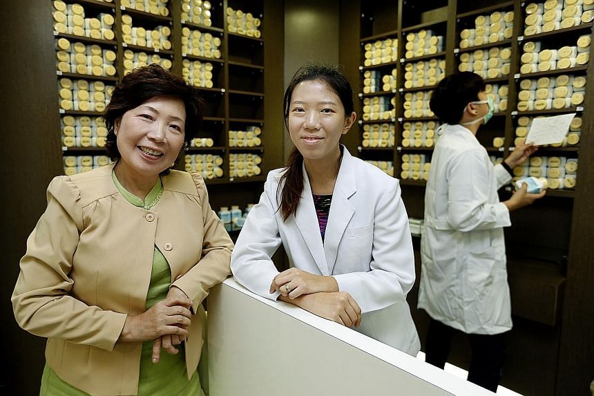 Singa Charity Medical coordinator and co-founder Tea Poh Choo (at far left) and TCM physician Jiang Xinlin (centre). The clinic in Veerasamy Road offers free consultations to patients, with a focus on those with cancer or metabolic diseases such as h