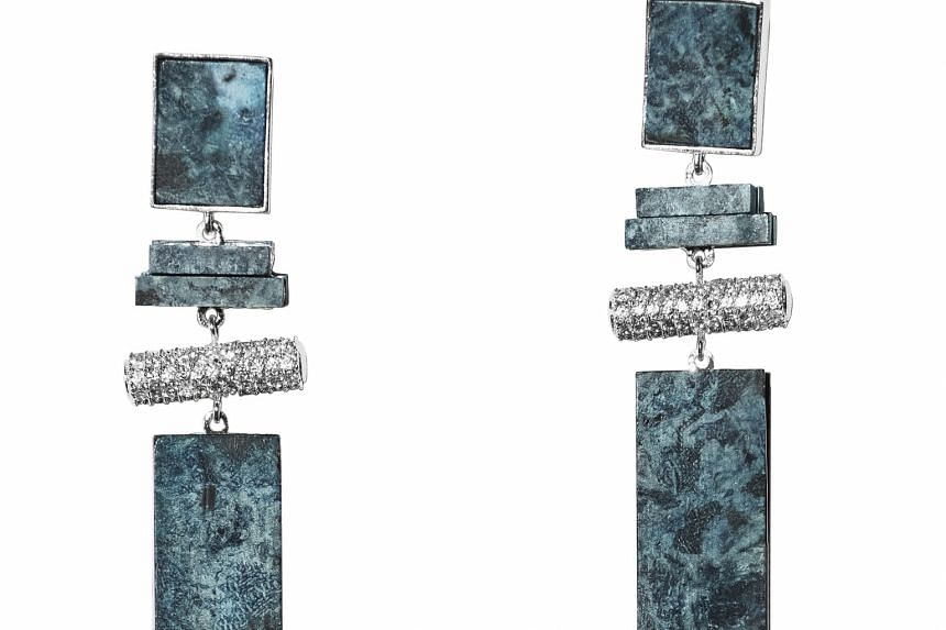 H&M's Conscious Exclusive collection will feature items such as tunics and earrings embellished with beads and rhinestones that are made from recycled glass and worn denim.