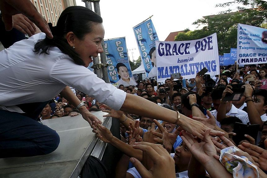 Ms Grace Poe greeting her supporters in October. The latest poll results show she is in a tie for the lead to be the next Philippine president with another candidate. However, the seven-man election commission ruled yesterday that Ms Poe is not quali
