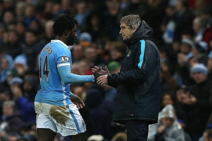 Manchester City's manager Manuel Pellegrini (left) greeting Wilfried Bony after the striker scored against Swansea. But the Ivory Coast international was dropped for the next match against Arsenal.